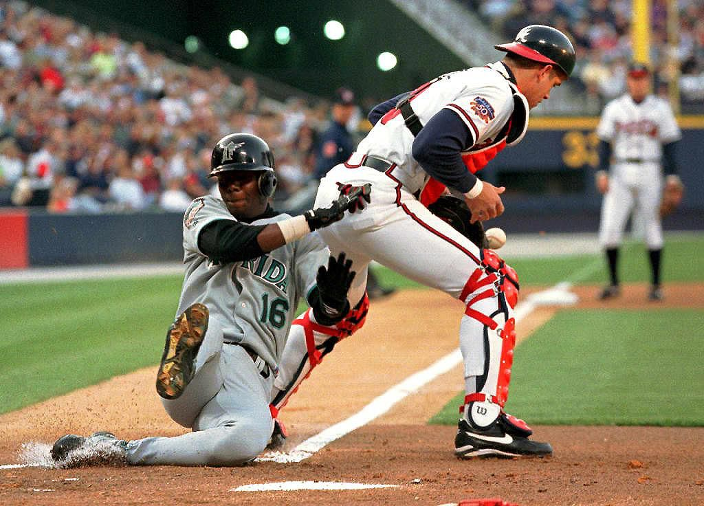 Florida Marlins' Ralph Milliard slides in to home
