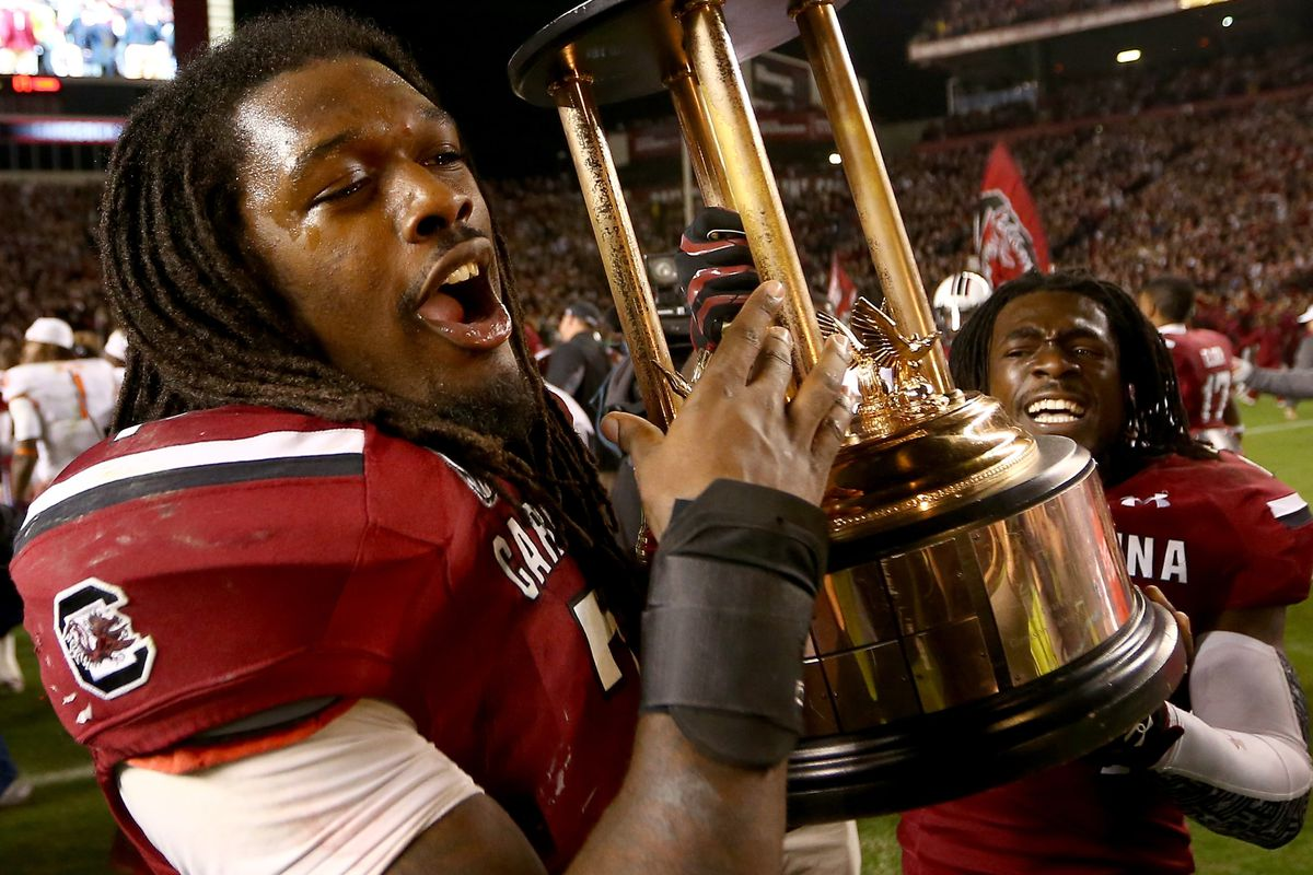 Clowney and Hampton are probably about to sell this trophy for rap CDs.