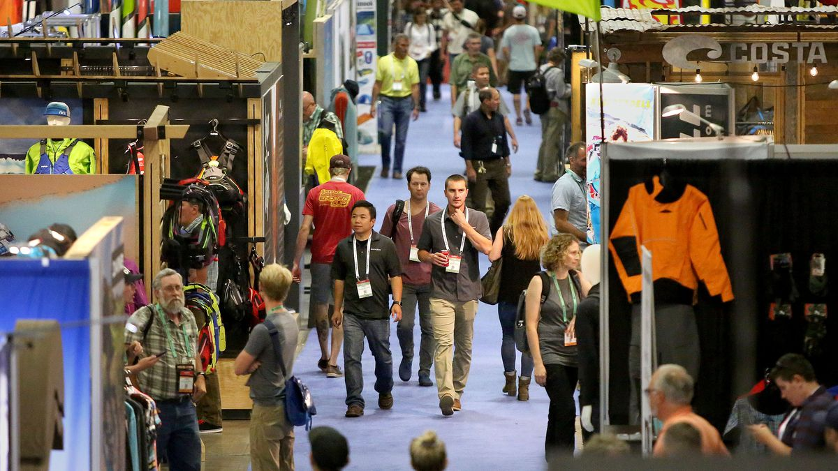 People walk through the Outdoor Retailer show at the Salt Palace Convention Center in Salt Lake City on Friday, July 28, 2017.