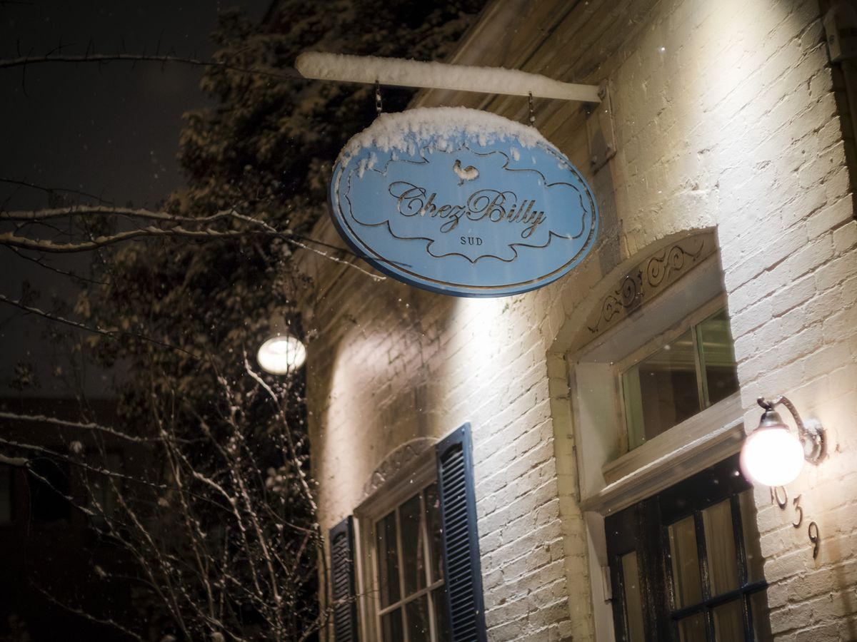 Snow falls outside of Chez Billy Sud in Washington...