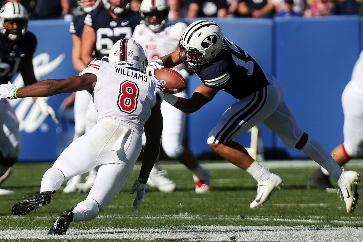 Northern Illinois Huskies safety Mykelti Williams breaks up a pass to Brigham Young Cougars wide receiver Aleva Hifo (15)during NCAA football in Provo on Saturday, Oct. 27, 2018.