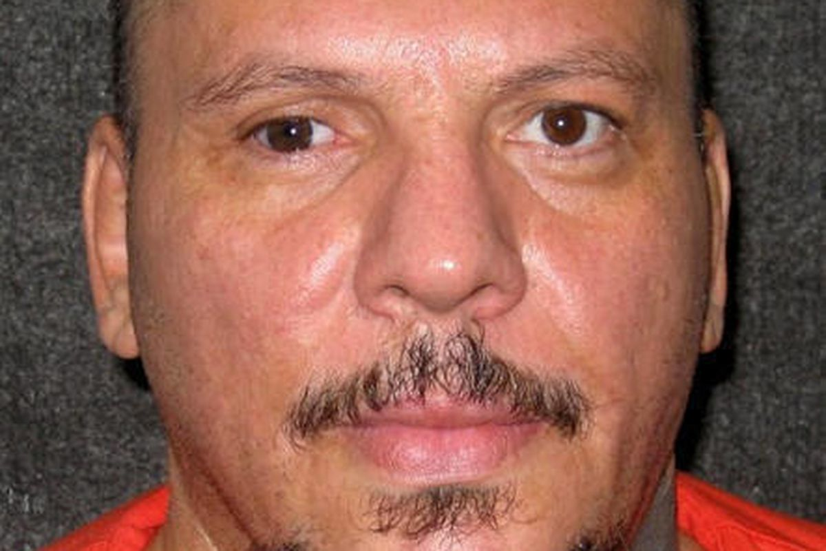 FILE - This undated file photo released on Tuesday Feb. 21,2012, provided by the Utah Department of Corrections shows death row inmate Michael Archuleta.  A judge has halted the firing squad execution of the 50-year-old Archuleta convicted of torturing an