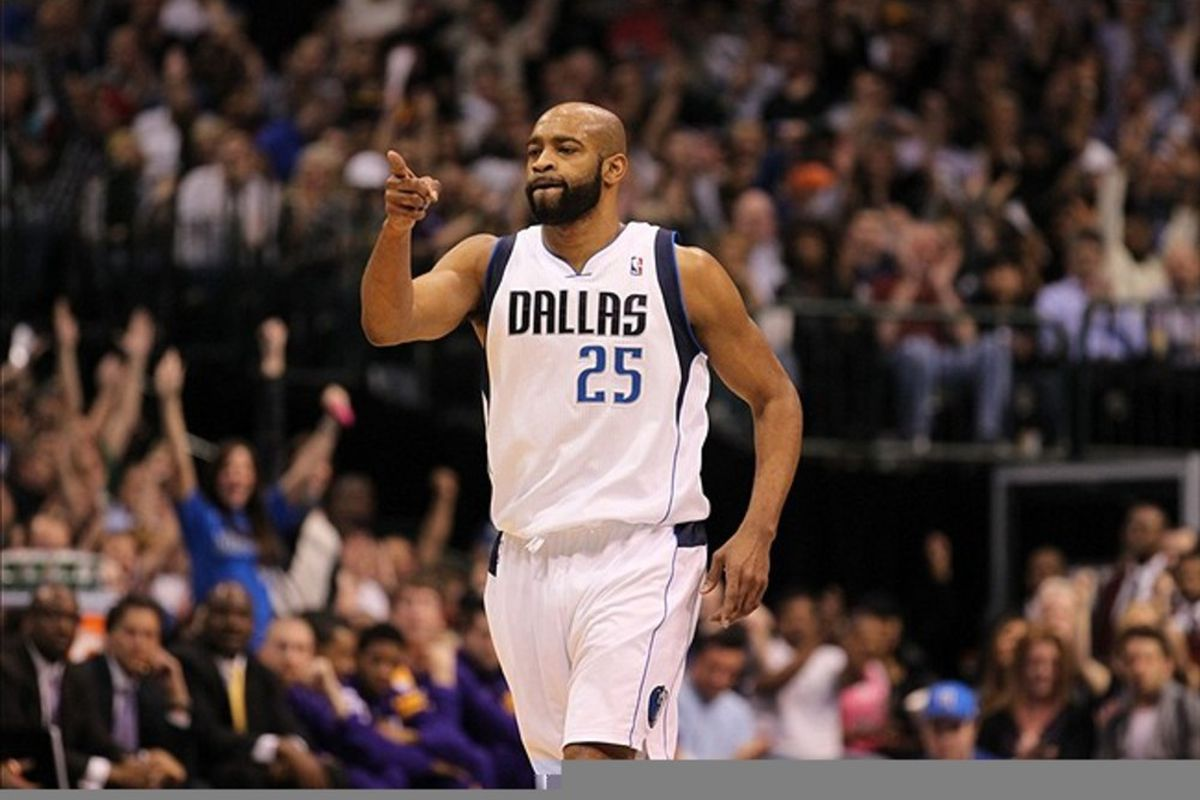 Feb 22, 2012; Dallas, TX, USA; Dallas Mavericks guard Vince Carter (25) celebrates afetr making a three point basket against the Los Angeles Lakers at American Airlines Center.  Mandatory Credit: Matthew Emmons-US PRESSWIRE