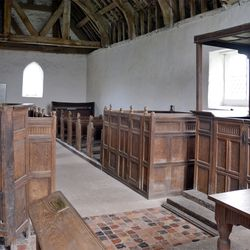 Interior view of the Langley Puritan Chapel shows the pulpit, left; reading desk, upper right; and communion table, lower right.