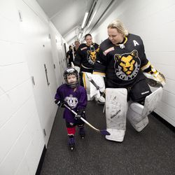Boston Pride goaltender Brittany Ott and the honorary captain before a game in Boston, MA on Dec. 16.