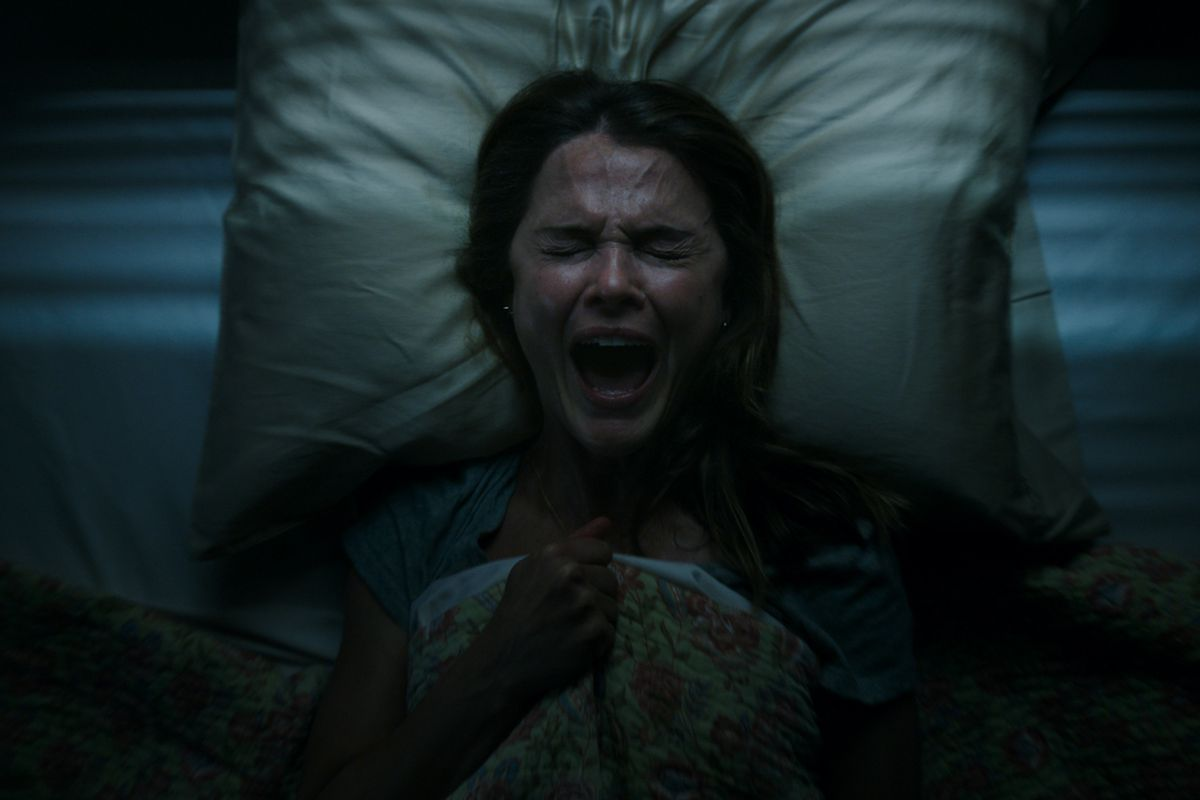a woman screams in bed in Antlers