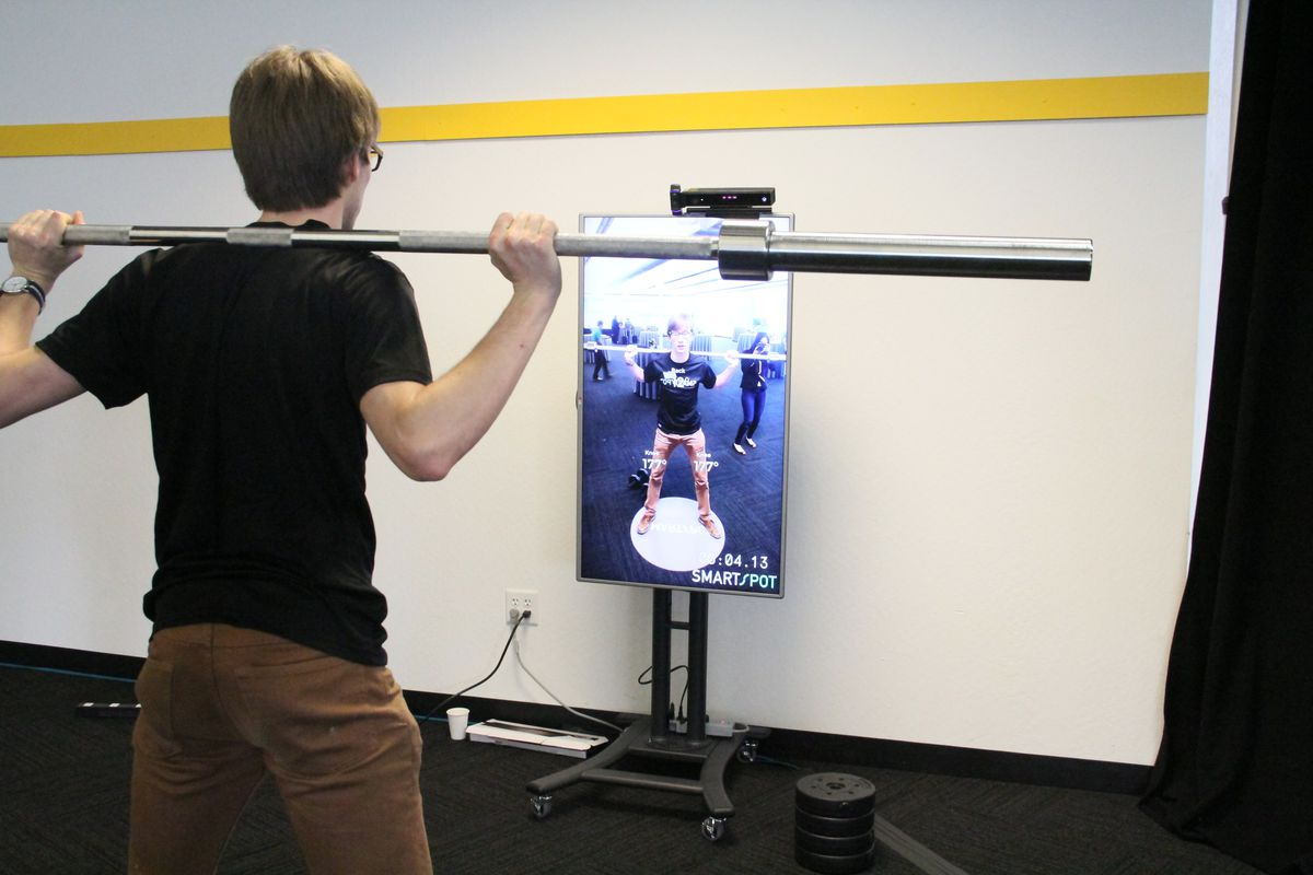 """YC Demo Day company SmartSpot uses an Xbox Kinect and an LG display to create a """"smart"""" mirror that guides you while you're working out."""