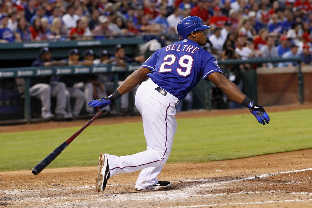April 25, 2012; Arlington, TX, USA; Texas Rangers third baseman Adrian Beltre (29) connects for a hit during the third inning against the New York Yankees at Rangers Ballpark in Arlington. Mandatory Credit: Jim Cowsert-US PRESSWIRE
