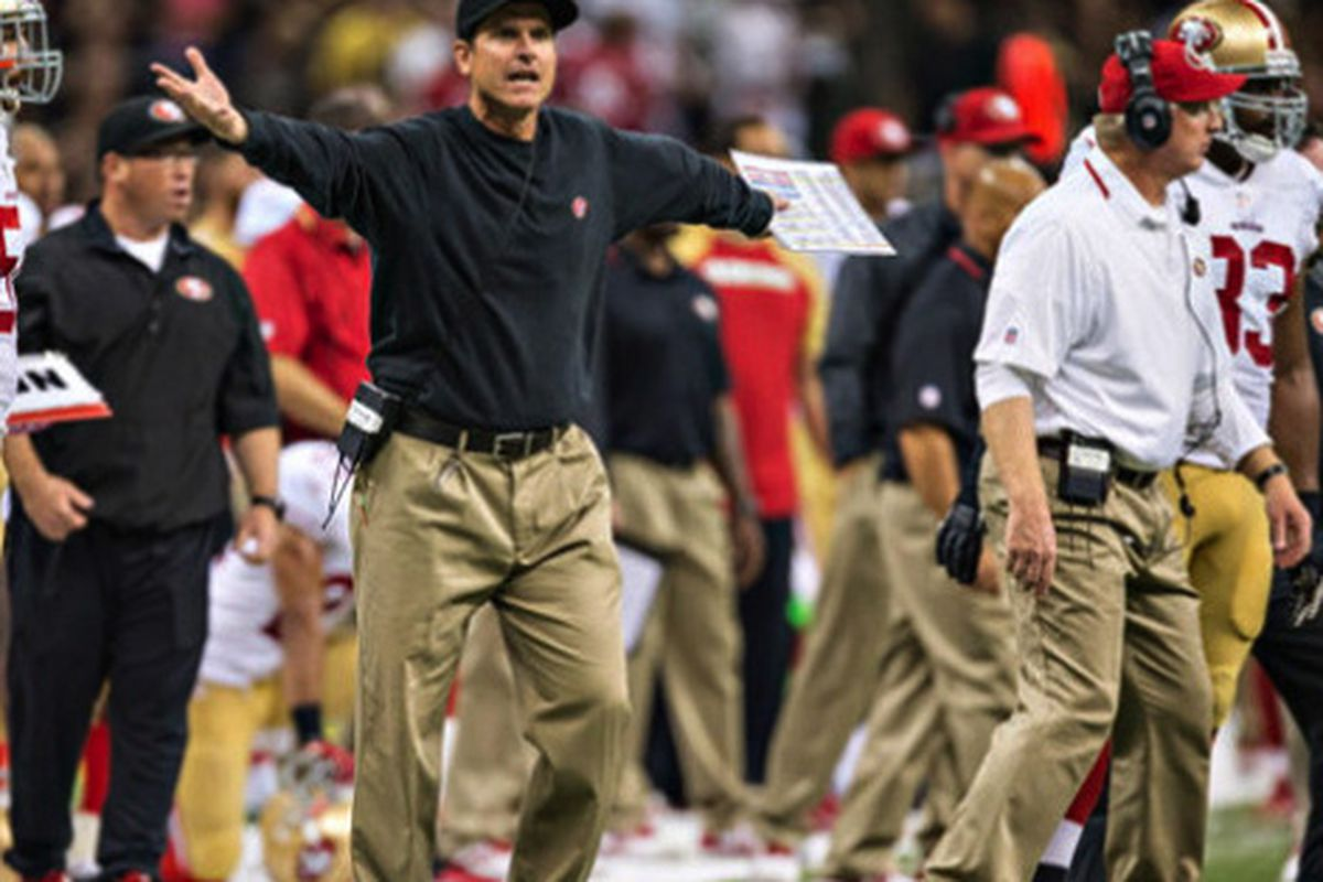 """Jim Harbaugh wears dad pants in this undated photo. Nothing has changed. Image via <a href=""""http://www.sportsgrid.com/nfl/sarah-harbaugh-tells-radio-listeners-husband-jim-buys-8-pants-from-walmart-and-she-has-nothing-to-do-with-it/"""">Sports Grid</a>"""