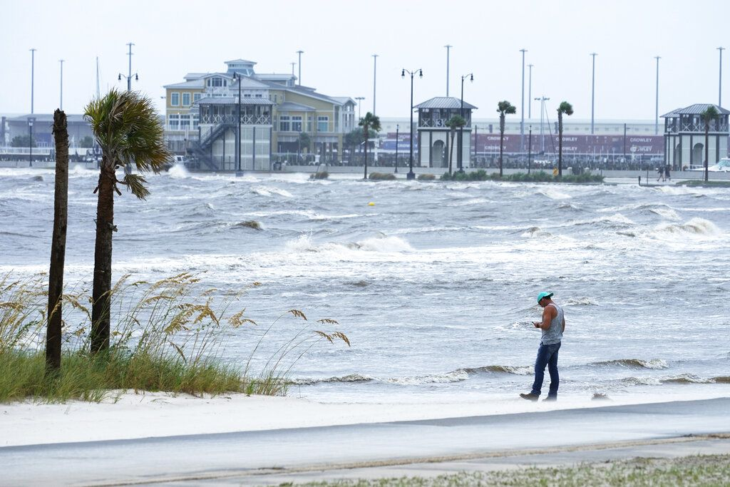 A person watches the wind during Hurricane Ida.