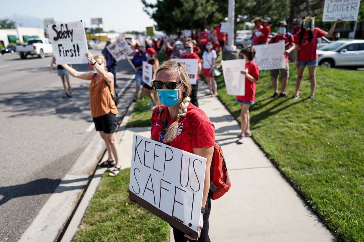 Jenny Gelwix, a third grade teacher at Eastwood Elementary in Salt Lake City, joins other Granite School District teachers, staff and supporters in a protest outside of the district office in South Salt Lake on Tuesday, Aug. 4, 2020.