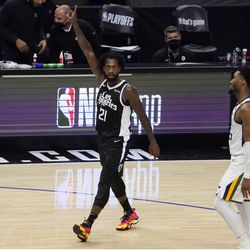 Los Angeles Clippers guard Patrick Beverley, left, celebrates as Utah Jazz guard Donovan Mitchell looks on during the closing minutes of the second half in Game 6 of a second-round NBA basketball playoff series Friday, June 18, 2021, in Los Angeles.