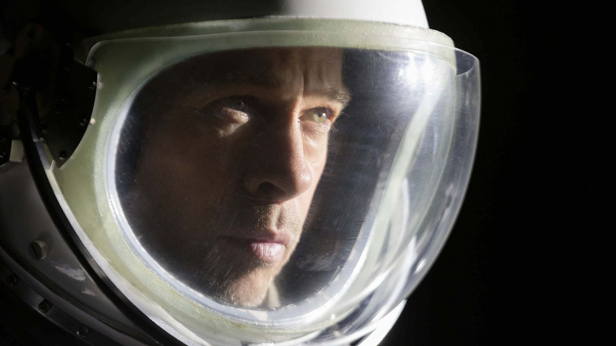 brad pitt as roy the astronaut floating through the blackness of space in ad astra
