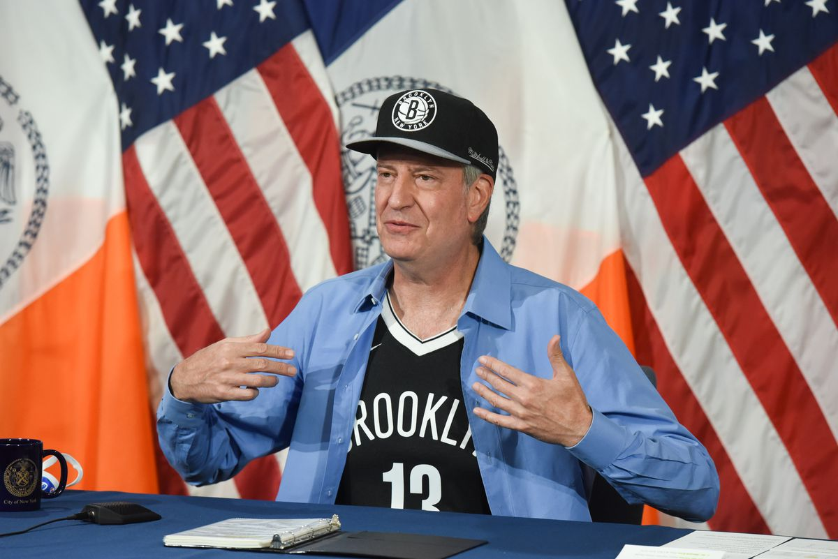 Mayor Bill de Blasio wears Brooklyn Nets gear at City Hall on Tuesday, May 18, 2021.