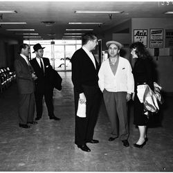 """Center in a white cardi on his way to Mexico in 1958. Photo via the <a href=""""http://digitallibrary.usc.edu/"""">USC Digital Library</a>."""