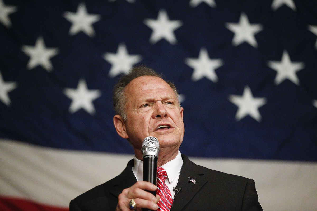 In this Dec. 5, 2017, photo, former Alabama Chief Justice and U.S. Senate candidate Roy Moore speaks at a campaign rally in Fairhope Ala. Moore has ignored all the rules of modern-day politics. But on the ground in Alabama, some believe the Republican Sen