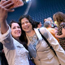 Maria Tedjamulia, left, takes a photograph with Sister Reyna I. Aburto, second counselor in the LDS Church's Relief Society general presidency, after the presidency spoke at the BYU Women's Conference in the Marriott Center at BYU in Provo on Friday, May 5, 2017.