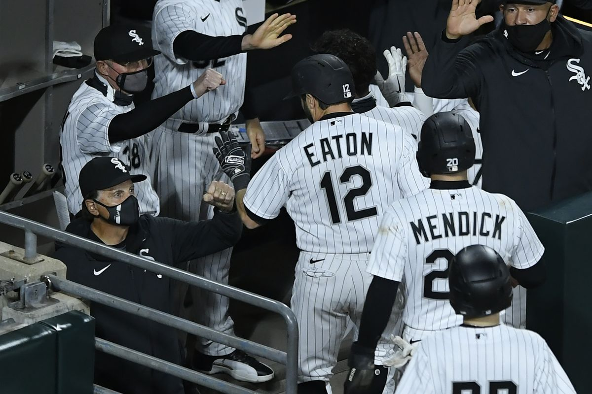 Adam Eaton gets a high five from manager Tony La Russa during a game against the Indians last month.