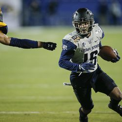 Utah State wide receiver Jordan Nathan (16) carries the ball as Kent State safety Elvis Hines (8) defends during the first half of the Frisco Bowl NCAA college football game Friday, Dec. 20, 2019, in Frisco, Texas.