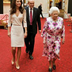 In a Joseph dress while viewing the exhibitions for the summer opening of Buckingham Palace on July 22nd, 2011 with Queen Elizabeth II.