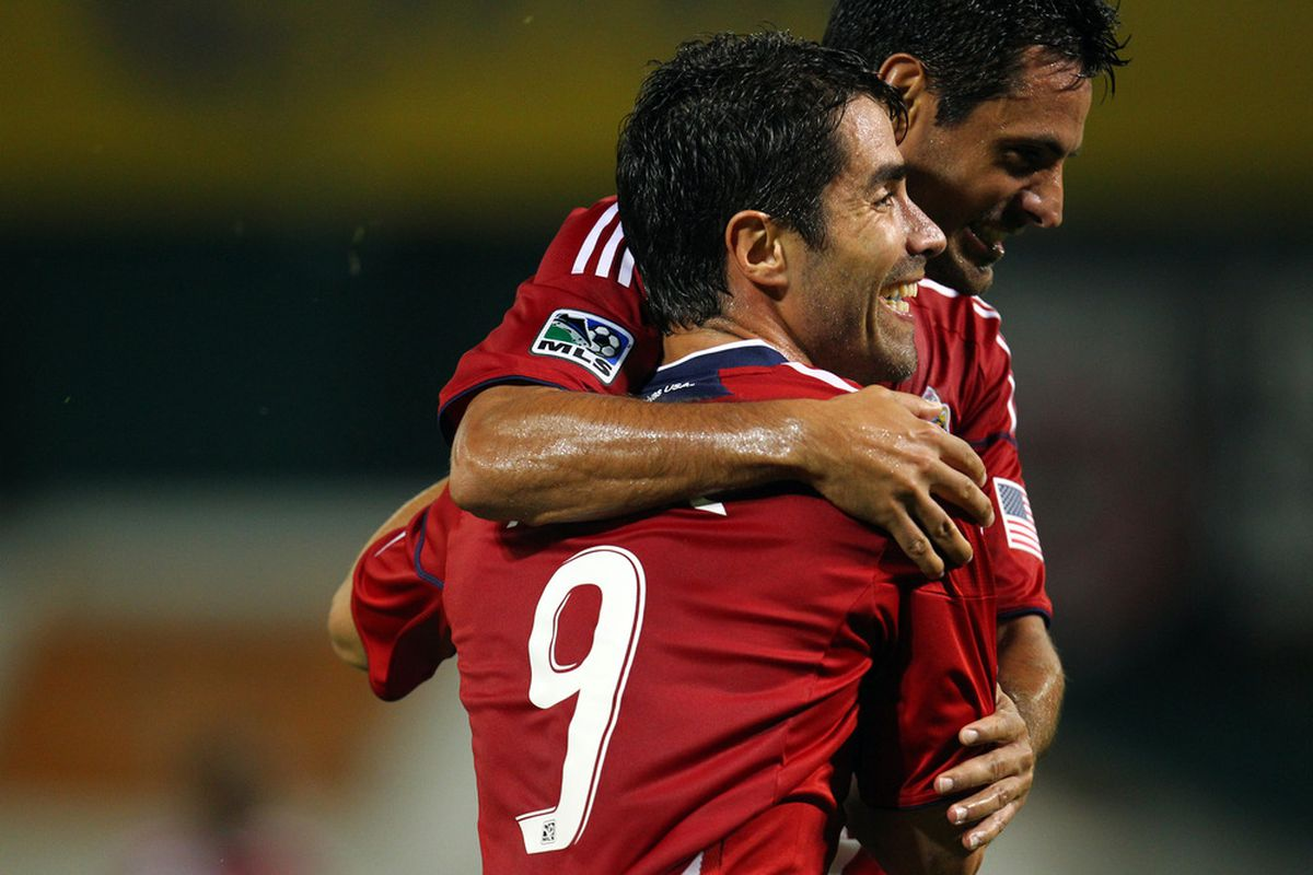 WASHINGTON, DC - SEPTEMBER 21: Juan Pablo Angel #9 of Chivas USA celebrates with Marcos Mondaini #23 after scoring a goal against D.C. United at RFK Stadium on September 21, 2011 in Washington, DC. (Photo by Ned Dishman/Getty Images)