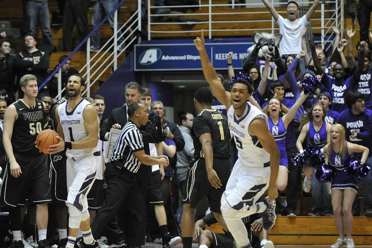 Northwestern celebrates after a hard-fought double overtime win over the Purdue Boilermakers