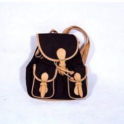 "<a href=""http://www.threadflip.com/items/4949""> Vintage black canvas backpack, $29.00</a>"