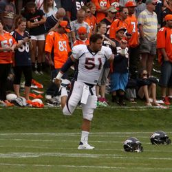 Denver Broncos center Steve Vallos stretches out during the fifth day of training camp