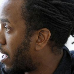 In this photo taken, Friday, April 6, 2012, artist Rashid Johnson speaks during an interview before his first solo exhibition at the Museum of Contemporary Art in Chicago. In the last year, the Chicago native whose works made from everyday objects explore his own life story as well as larger issues of black identity, has garnered high-profile attention and awards from the art world.