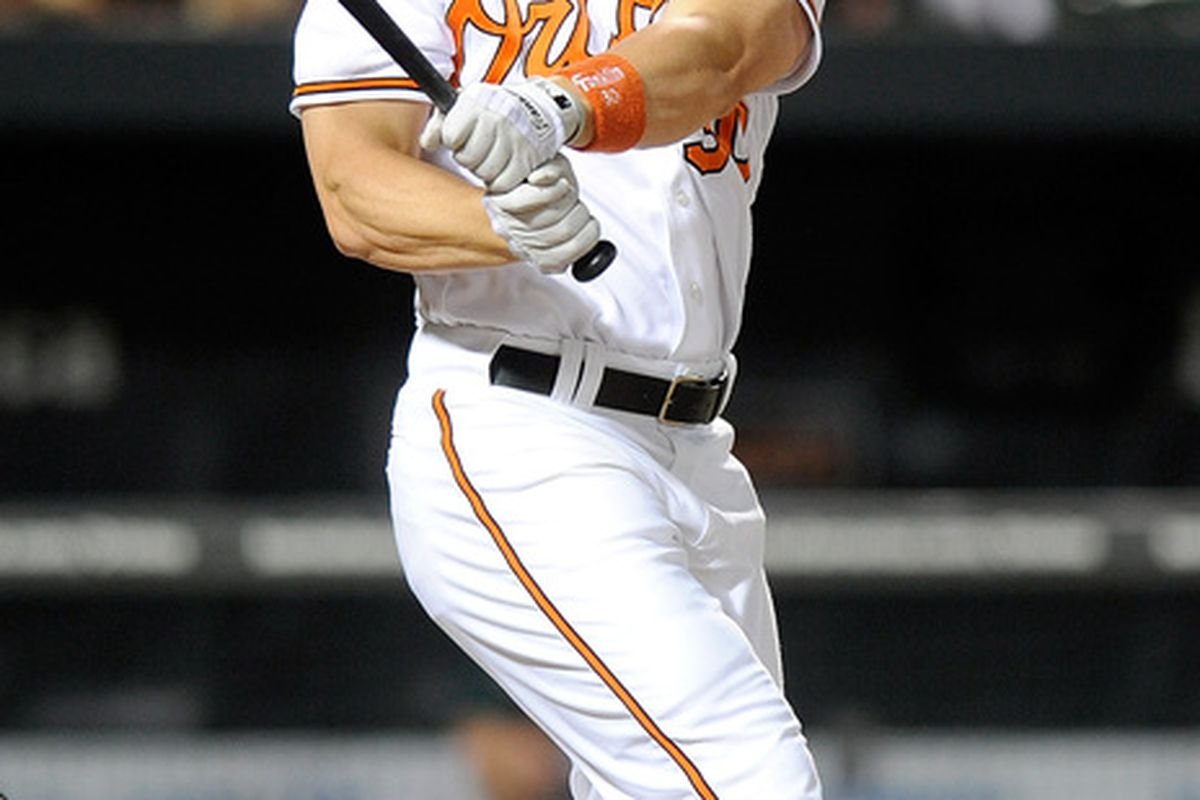 BALTIMORE - JUNE 30:  Luke Scott #30 of the Baltimore Orioles hits a home run in the seventh inning against the Oakland Athletics at Camden Yards on June 30