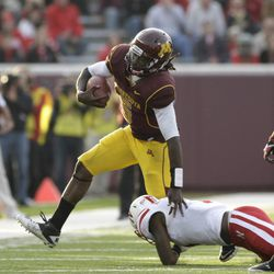Minnesota quarterback Marqueis Gray is brought down by Nebraska safety Harvey Jackson after a three-yard run during the second half of an NCAA college football game, Saturday, Oct. 22, 2011, in Minneapolis. Gray had a team-high 67 yards rushing on 17 carries as Nebraska won 41-14. (AP Photo/Paul Battaglia)