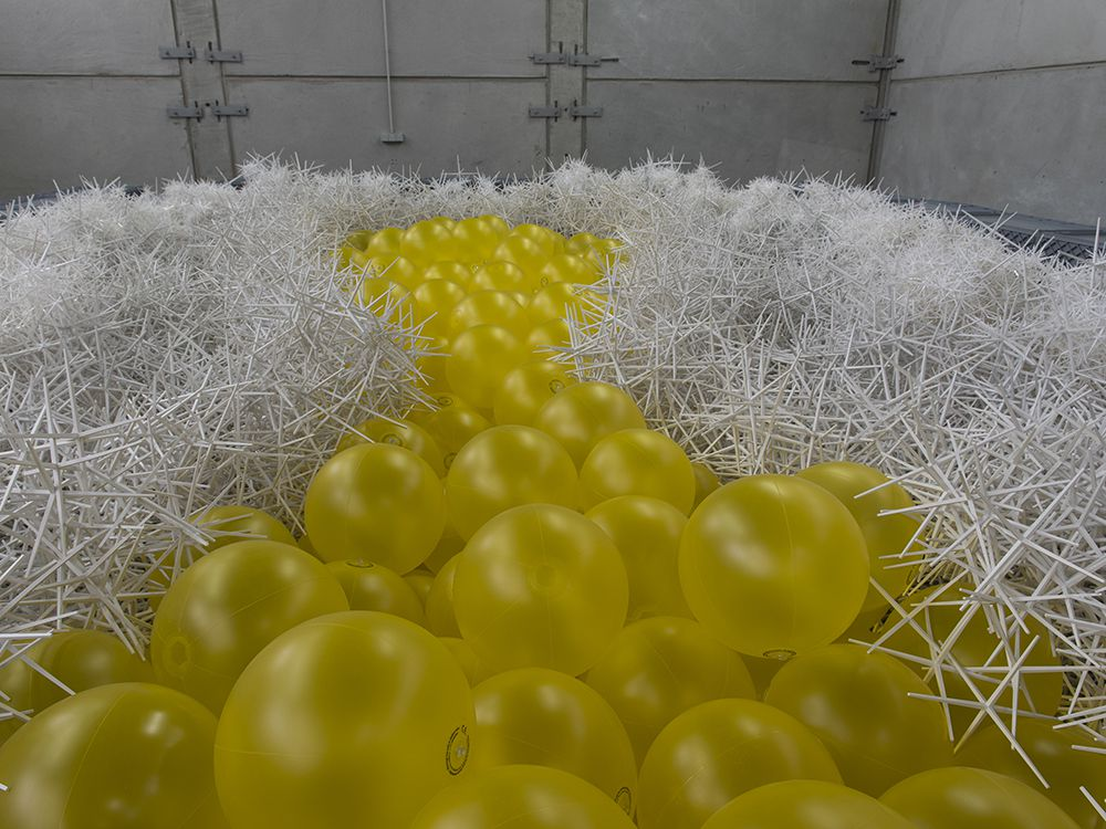 Yellow inflatable balls surrounded by white plastic pieces