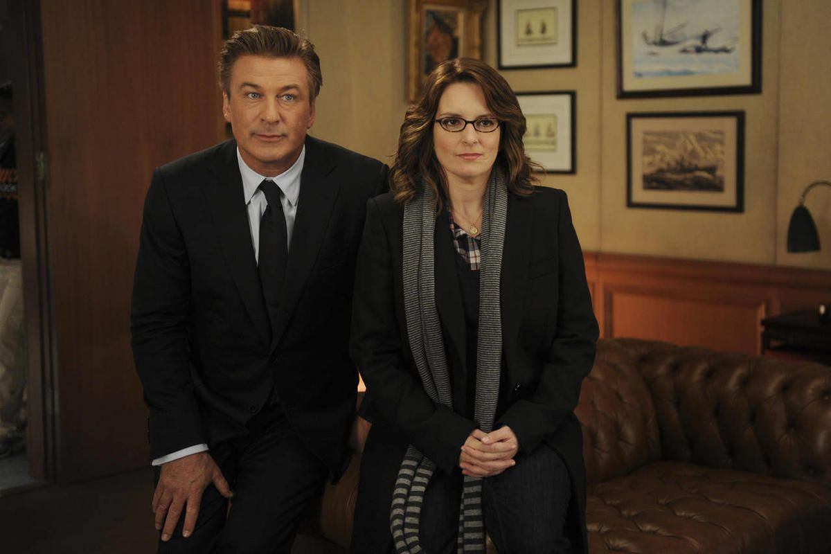 """In this 2011 image released by NBC, Alec Baldwin portrays Jack Donaghy, left, and Tina Fey portrays Liz Lemon in the NBC comedy series, """"30 Rock."""" The series will broadcast live on Thursday, April 26, 2012."""