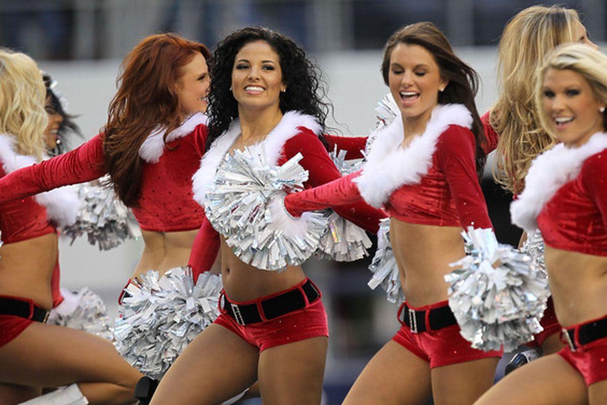 ARLINGTON TX - DECEMBER 19:  The Dallas Cowboys Cheerleaders perform at Cowboys Stadium on December 19 2010 in Arlington Texas.  (Photo by Ronald Martinez/Getty Images)