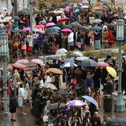 Women stand in line in the rain to attend The Church of Jesus Christ of Latter-Day Saints' General Women's Session of the 187th Annual General Conference in the Conference Center in Salt Lake City on Saturday, March 25, 2017.