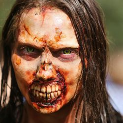 Casper Biesinger participates in the Zombie Walk in Salt Lake City Sunday, Aug. 30, 2015. The eighth annual Zombie Walk was held to raise awareness and donations for the Utah Food Bank.