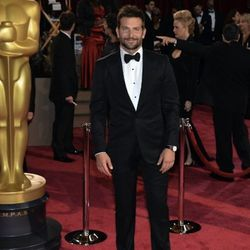 """""""<strong>Bradley Cooper</strong>. I thought his tux looked very cute. The patent lace-up shoes with a perfectly tailored pant really stood out as winners in his look. I especially loved the messy grooming they did with him, it was great."""" [Photo: Getty Im"""