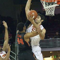 Omar Oraby tries to swat Devon Collier's shot.