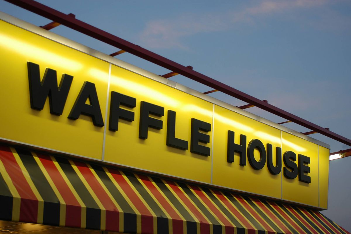 Waffle House's yellow signage below a red and green awning