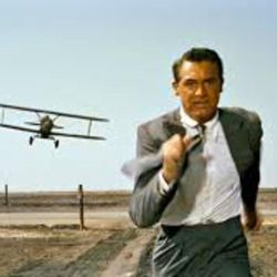 """Cary Grant is chased by a crop duster in this iconic moment from Alfred Hitchcock's """"North By Northwest"""" (1959)."""