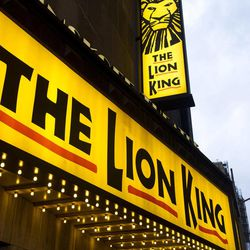 """FILE - In this Jan. 19, 2012 file photo, the Minskoff Theatre and the marquee for """"The Lion King"""" are seen in New York. Box office revenues show that """"The Lion King"""" has recently swiped the title of Broadway's all-time highest grossing show from """"The Phantom of the Opera."""""""