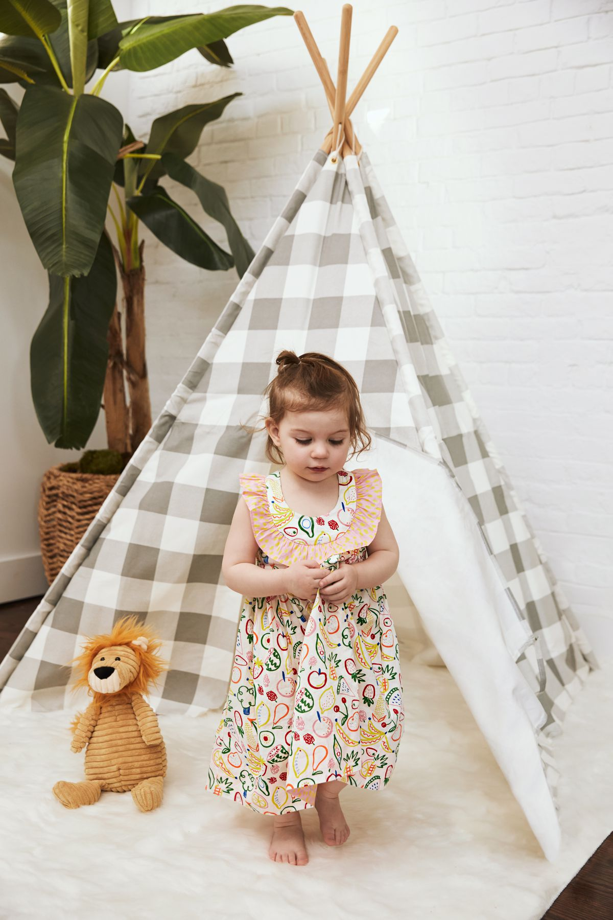little girl in a tent