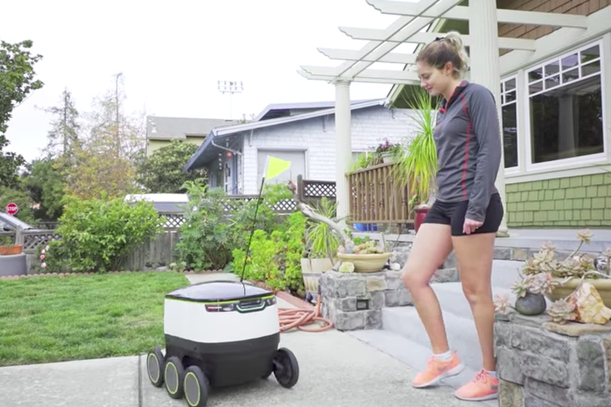 This image shows an autonomous delivery robot delivering something.