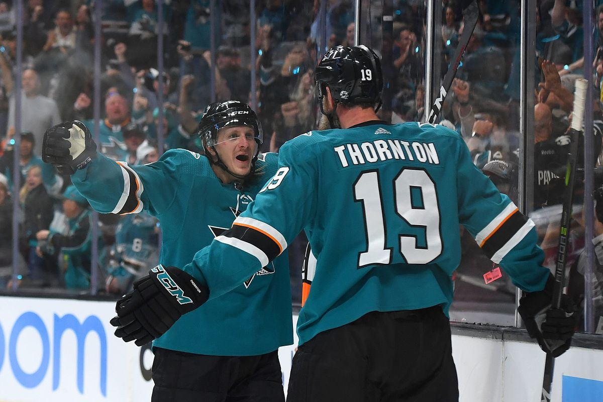 Joe Thornton of the San Jose Sharks is congratulated by Marcus Sorensen after Thornton scored a goal against the Colorado Avalanche during the second period in Game 1 of the Western Conference Second Round during the 2019 NHL Stanley Cup Playoffs at SAP C