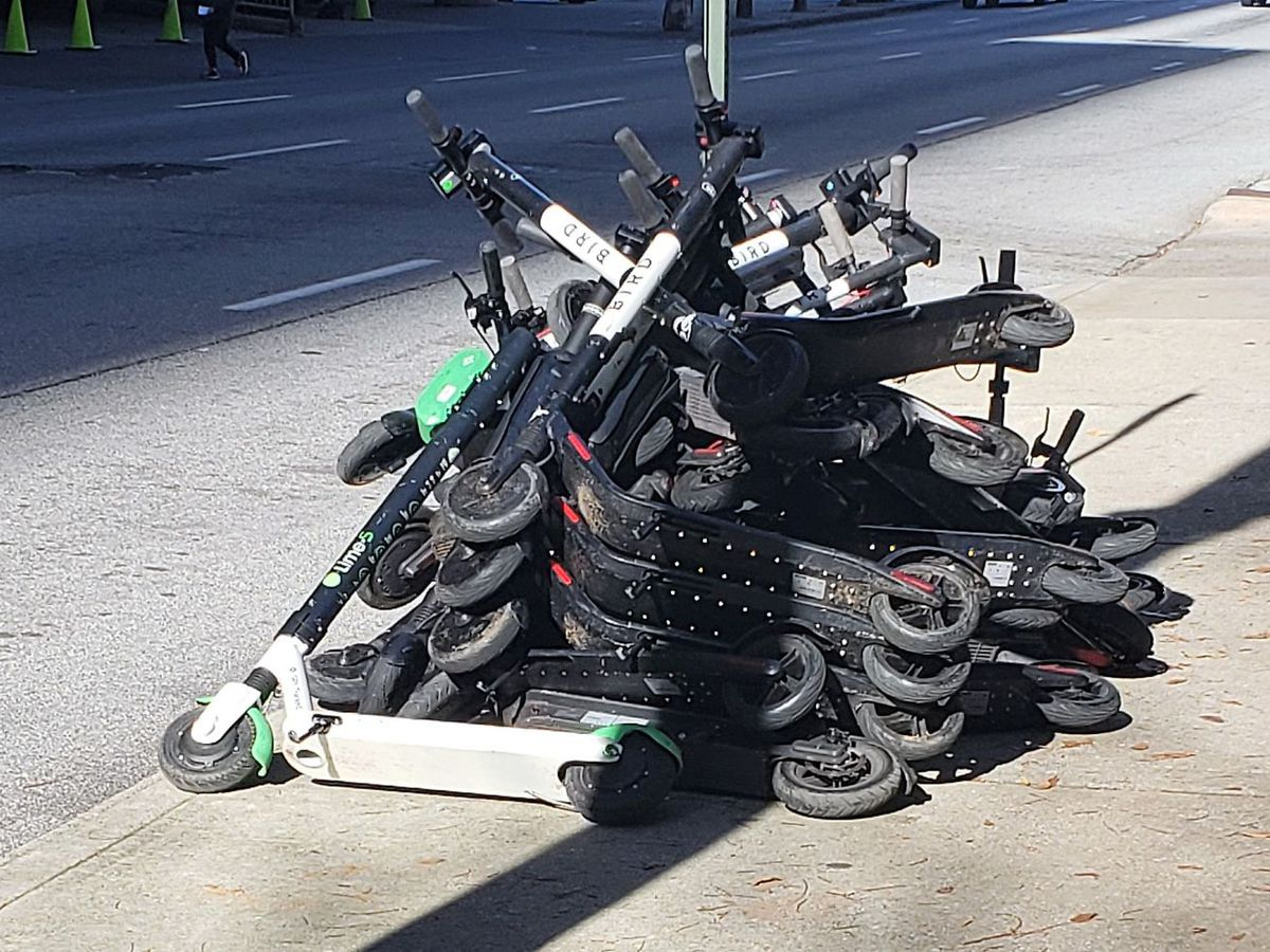 A pile of e-scooters on a downtown Atlanta street.