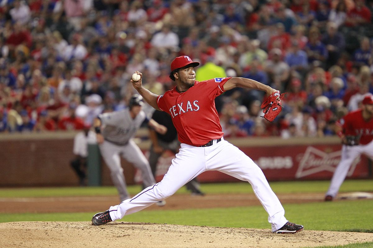 ARLINGTON, TX - APRIL 10: Neftali Feliz #30 of the Texas Rangers delivers a pitch against the Seattle Mariners at Rangers Ballpark in Arlington on April 10, 2012 in Arlington, Texas. (Photo by Rick Yeatts/Getty Images)