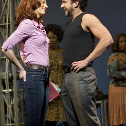 """In this theater image released by Boneau/Bryan-Brown, Jessica Phillips, left, and Raul Esparza are shown during a performance of """"Leap of Faith,"""" at the St. James Theatre in New York."""
