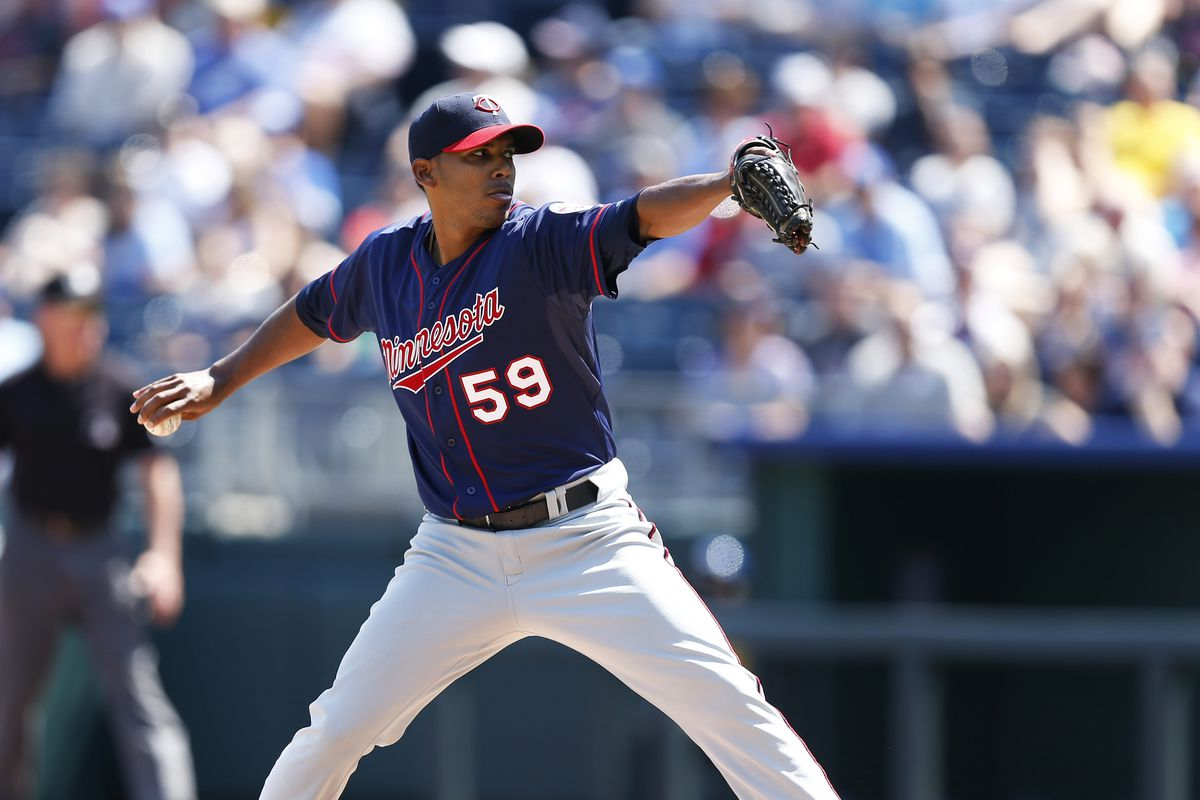 KANSAS CITY, MO - SEPTEMBER 2: Esmerling Vasquez #59 of the Minnesota Twins pitches against the Kansas City Royals during the game at Kauffman Stadium on September 2, 2012 in Kansas City, Missouri. (Photo by Joe Robbins/Getty Images)