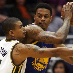 Utah Jazz guard Earl Watson (11) defends Golden State's #4 Brandon Rush as the Utah Jazz and the Golden State Warriors play Friday, April 6, 2012 in Salt Lake City. Jazz won 104-98.
