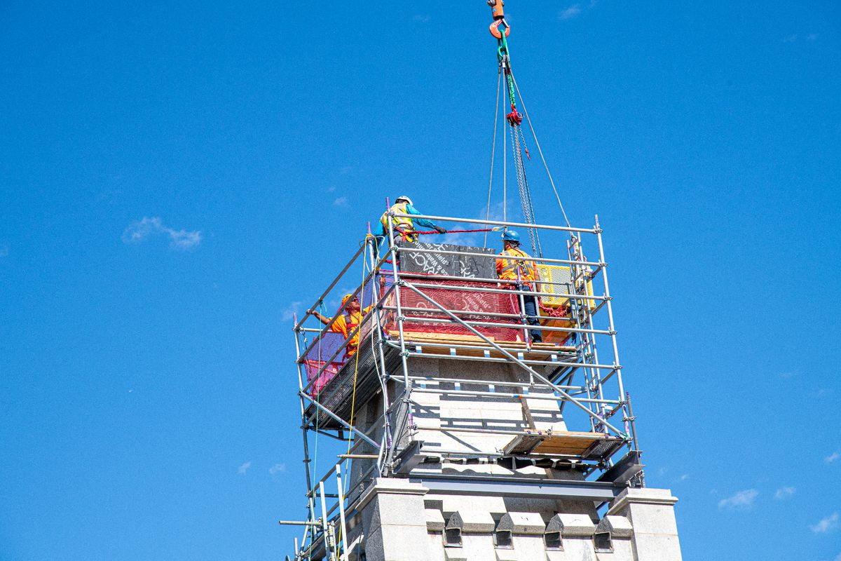 Workers remove stones from the top of the Salt Lake Temple during a major renovation.